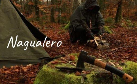 Nagualero prepping the fire in the rain