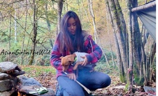 asiangirlinthewild camping alone in wood with her dog Moana