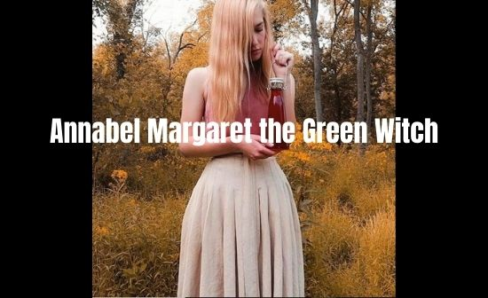 Annabel Margaret the Green Witch holding simple raspberry thyme vinegar recipe
