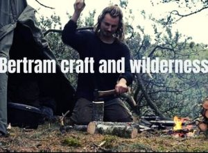 Bertram craft and wilderness chopping woods in dense forest of Denmark