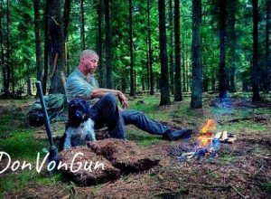 DonVonGun with his dog Musen resting near a outdoor camp