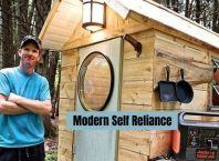 Modern Self Reliance Kevin Leclair relaxing after building mini cubic wood stove.